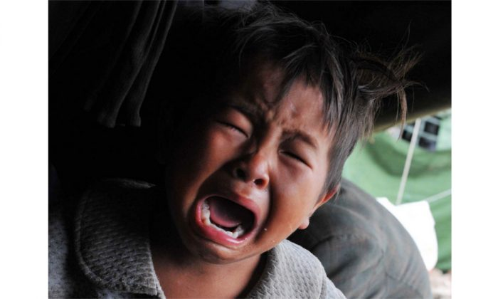 A crying boy. (STR/AFP/Getty Images)