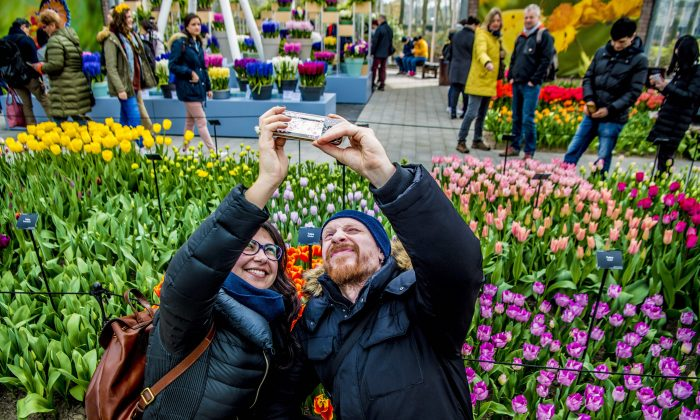 Tourists take selfies among tulips at the Keukenhof garden in Lisse, Netherlands, in this file photo. (Robin Utrecht/AFP/Getty Images)