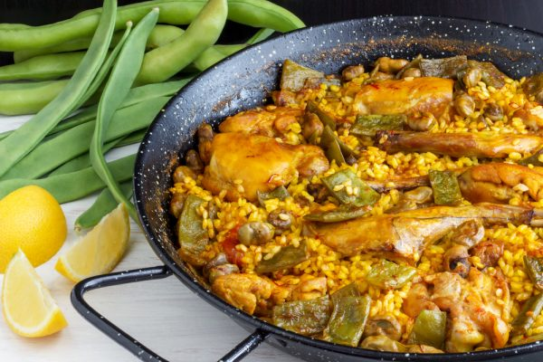paella valenciana with lemon and peas