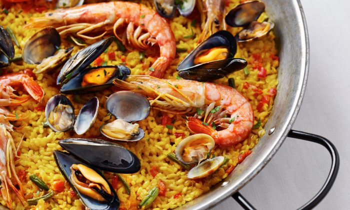 A hearty pan of paella, always served family-style, is a Spanish tradition. (Shutterstock)