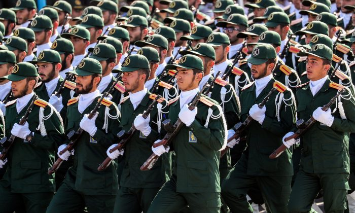 Members of Iran's Revolutionary Guards Corps (IRGC) march in a military parade in Tehran in this file photo. (Stringer/AFP/Getty Images)