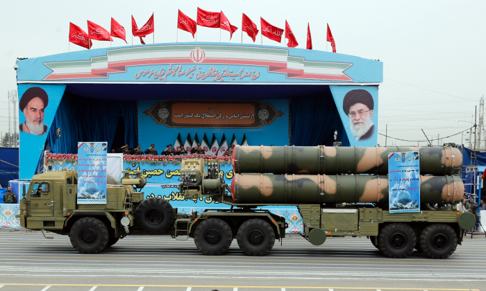 An S-300 missile system drives in front of the officials' stand during a military parade marking the annual Iranian National Army Day in Tehran on April 18, 2019. (AFP/Getty Images)