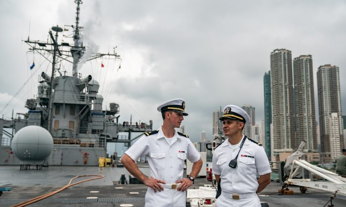 Navy crew members stand on deck of the USS Blue Ridge during a port call in Hong Kong on April 20, 2019. (Photo by Anthony Kwan/Getty Images)