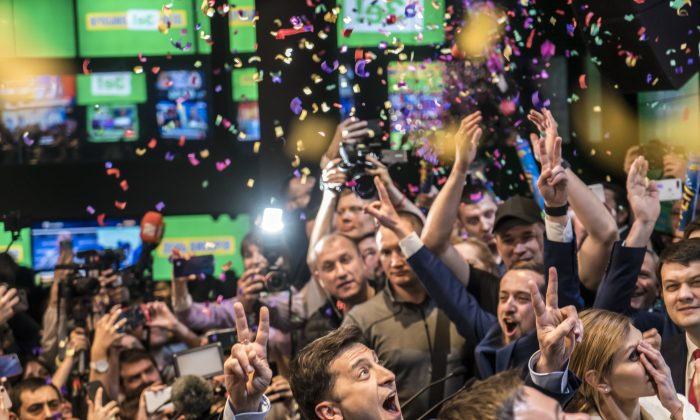 Volodymyr Zelenskiy (C) celebrates his apparent victory in Ukraine's presidential race at his election-day headquarters after polls closed in Kiev, Ukraine on April 21, 2019. (Brendan Hoffman/Getty Images)