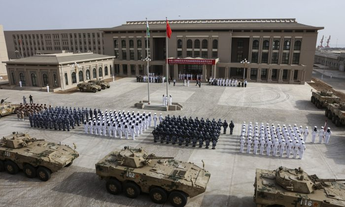 Chinese People's Liberation Army personnel attending the opening ceremony of China's new military base in Djibouti, China, on Aug. 1, 2017. (STR/AFP/Getty Images)