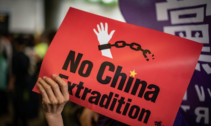 A protester holds a placard during a rally against the extradition law outside the Legislative Council building in Hong Kong, China, on May 4, 2019. (Anthony Kwan/Getty Images)