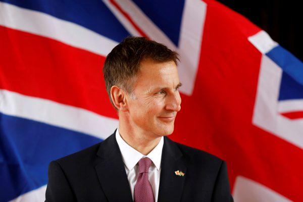 Britain's Foreign Secretary Jeremy Hunt looks at Kenya's Foreign Affairs Cabinet Secretary Monica Juma