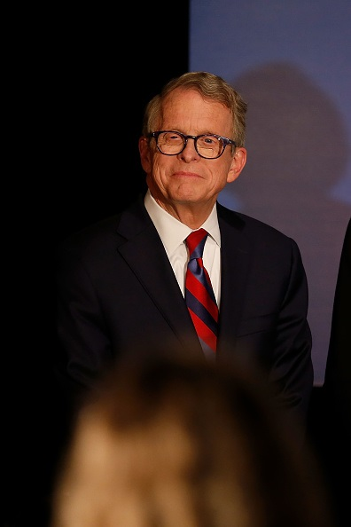 Republican Gubernatorial Candidate Ohio Attorney General Mike DeWine listens as Governor John Kasich gives a speech