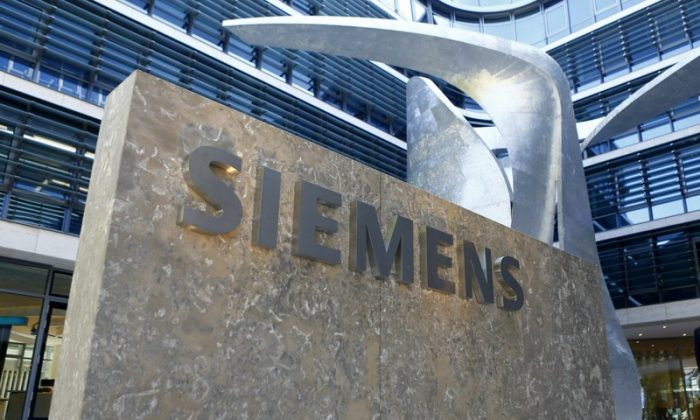 The logo of German industrial conglomerate Siemens at the new headquarters in Munich, Germany, on June 24, 2016. (Matthias Schrader/File Photo via AP)