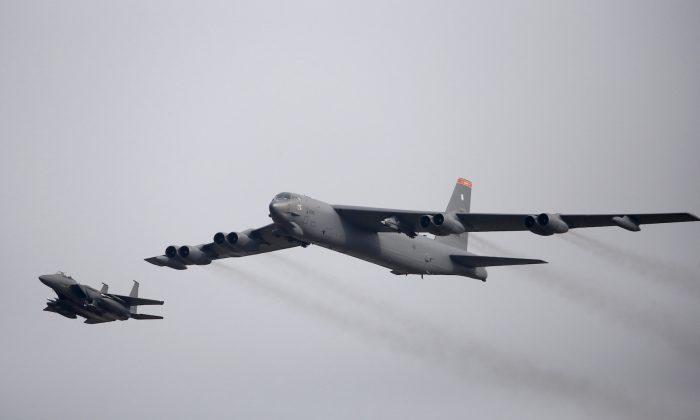 A U.S. Air Force B-52 (R) flies over Osan Air Base in Pyeongtaek, South Korea, on Jan. 10, 2016. (Reuters/Kim Hong-Ji/File Photo)