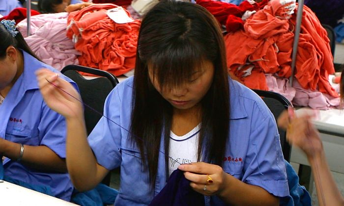 A woman sewing in a factory in China. (China Photos/Getty Images)