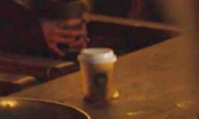 Twitter is convinced it's a Starbucks cup, but it really could be from anywhere. (HBO via CNN)