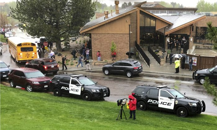 Police and others are seen outside a recreation center where students are reunited with their parents, in the Denver suburb of Highlands Ranch, Colo., after a shooting at STEM School Highlands Ranch May 7, 2019. (David Zalubowski/AP)
