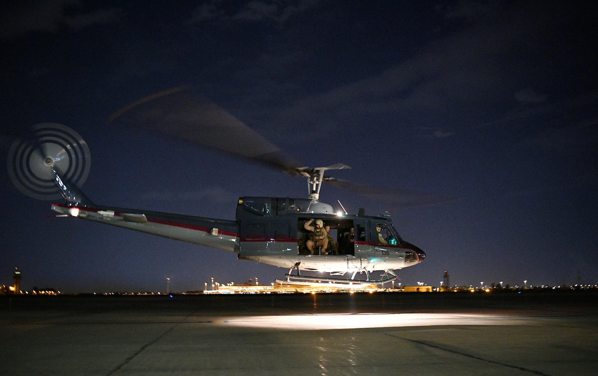 A helicopter carrying U.S. Secretary of State Mike Pompeo takes off from Baghdad International Airport in Baghdad
