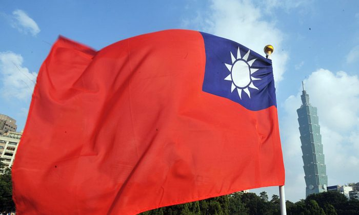 Taiwan's national flag flutters beside Taipei 101 at Sun Yat-sen Memorial Hall in Taipei on Oct. 7, 2012. (Mandy Cheng/AFP/Getty Images)