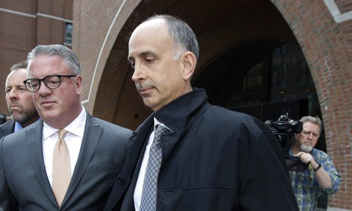 California businessman Stephen Semprevivo departs federal court in Boston, on May 7, 2019, after pleading guilty to charges that he bribed the Georgetown tennis coach to get his son admitted to the school. (Steven Senne/AP Photo)