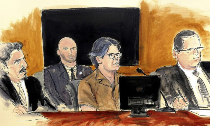 In this April 13, 2018, courtroom sketch, Keith Raniere, second from right, leader of the secretive group NXIVM, attends a hearing at court in the Brooklyn borough of New York. (Elizabeth Williams via AP, File)