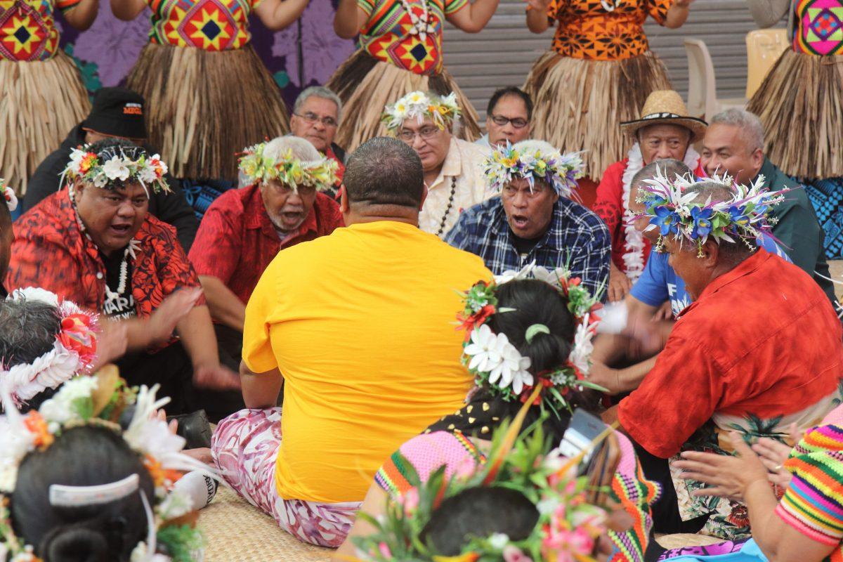 Tuvaluan men chant and drum