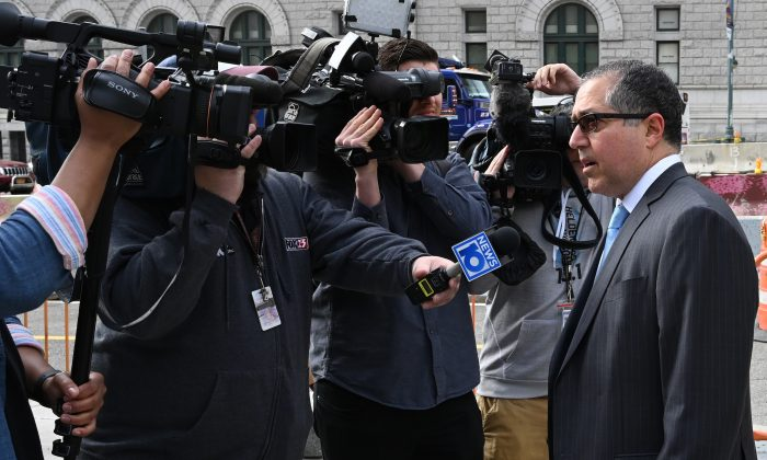 Keith Raniere's lawyer, Marc Agnifilo, speaks to the press as he arrives at Brooklyn Federal Court in New York on May 7, 2019. (Timothy A. Clary/AFP/Getty Images)