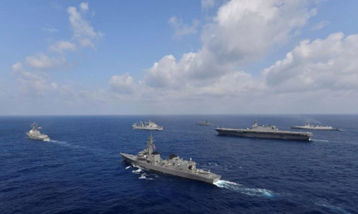 Vessels from the U.S. Navy, Indian Navy, Japan Maritime Self-Defense Force and the Philippine Navy sail in formation at sea on May 9, 2019. (Japan Maritime Self-Defense Force/Handout via Reuters)