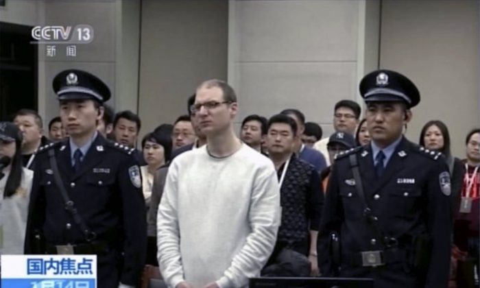 Video footage run by China's CCTV shows Canadian Robert Lloyd Schellenberg at his retrial held in Dalian Intermediate People's Court in Dalian, Liaoning Province, China. A Chinese court has held an appeal hearing on May 9 for the Canadian who was sentenced to death for drug smuggling. No decision was immediately announced after the hearing. (CCTV via AP)