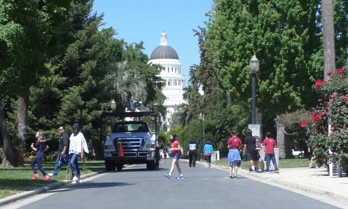 People walking near the capitol building in Sacramento, Calif., on May 8, 2019. (Daniel Holl/The Epoch Times)