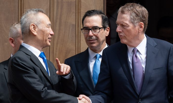 Chinese Vice Premier Liu He (L) shakes hands with US Trade Representative Robert Lighthizer (R) alongside US Treasury Secretary Steven Mnuchin (C) as Liu leaves the Office of the United States Trade Representative after trade negotiations in Washington, DC, May 10, 2019. (Saul Loeb/AFP/Getty Images)