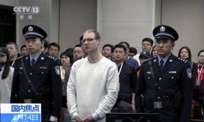 Canadian Robert Lloyd Schellenberg attends his retrial at the Dalian Intermediate People's Court in Dalian, northeastern China's Liaoning province on Jan. 14, 2019. (CCTV via AP)