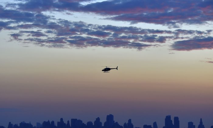 A helicopter flies over Brooklyn, New York City on July 1, 2017. (Loic Venance/AFP/Getty Images)
