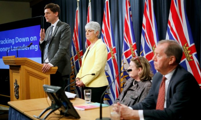 Minister of Finance Carole James and Attorney General David Eby release details found in a recent report done by an expert panel about billions in money laundering in the province as chair of the expert panel Maureen Maloney and Peter German look on during a press conference at Legislature in Victoria, B.C., on May 9, 2019. (Chad Hipolito/The Canadian Press)