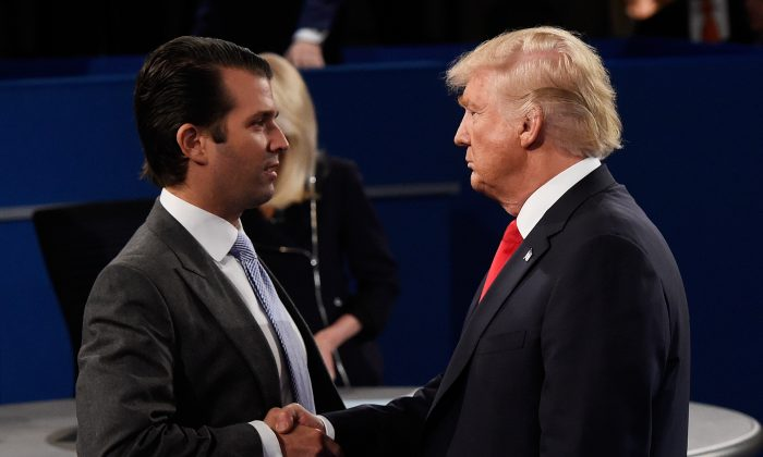 Donald Trump, Jr. (L) greets his father Republican presidential nominee Donald Trump during the town hall debate at Washington University in St Louis, Mo. on Oct. 9, 2016. (Saul Loeb-Pool/Getty Images)