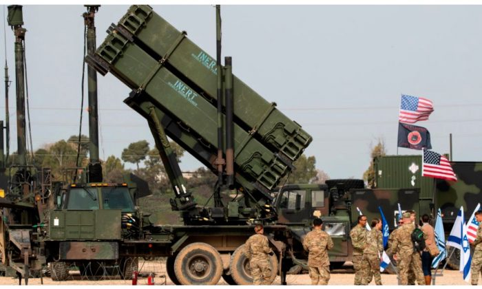 US army officers stands in front a U.S. Patriot missile defense system at the Hatzor Airforce Base on March 8, 2018. (Jack Guez/AFP/Getty Images)