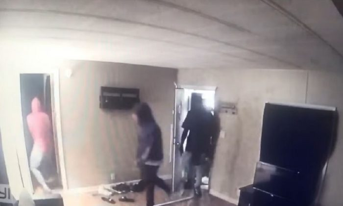 Home security footage captured the moment four robbers burst into a home in Bowling Green, Kentucky. (Warren County Sheriff's Office)
