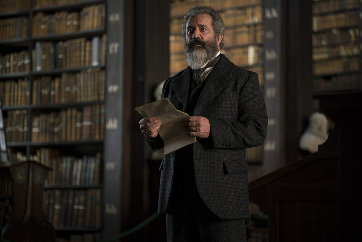 19th century man with letter in library