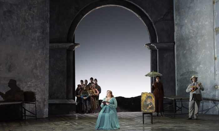 "Tamara Wilson as Desdemona (centre), Carolyn Sproule as Emilia (right), and Owen McCausland as Roderigo in a scene from the Canadian Opera Company's 2019 production of ""Otello."" (Michael Cooper)"
