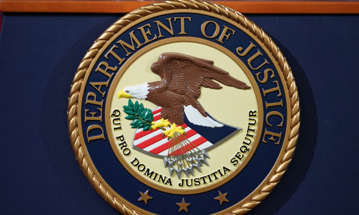 The U.S. Department of Justice seal is seen on a lectern ahead of a press conference at the Department of Justice building in Washington on Nov. 28, 2018. (MANDEL NGAN/AFP/Getty Images)