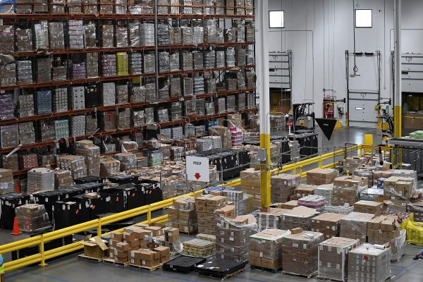Products, stacked on shelves, are seen at the Amazon fulfillment center