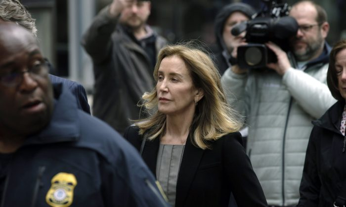 Felicity Huffman arrives at federal court in Boston, where she pleaded guilty to charges in a nationwide college admissions bribery scandal, on May 13, 2019. (Steven Senne/AP Photo)