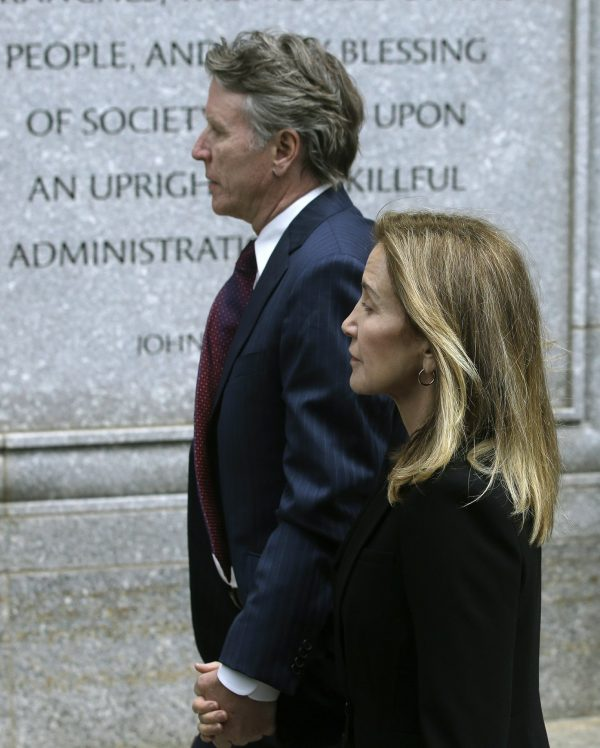 Felicity Huffman arrives with her brother