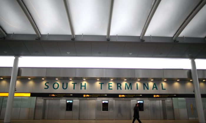 A passenger walks through Gatwick's South Terminal in London on Jan. 18, 2013. (Jordan Mansfield/Getty Images)