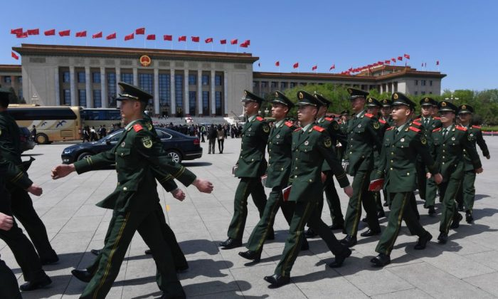 Paramilitary police officers march in Tiananmen Square after attending a ceremony marking the centennial of the May Fourth Movement, a landmark student protest against colonialism and imperialism, in Beijing on April 30, 2019. (GREG BAKER/AFP/Getty Images)