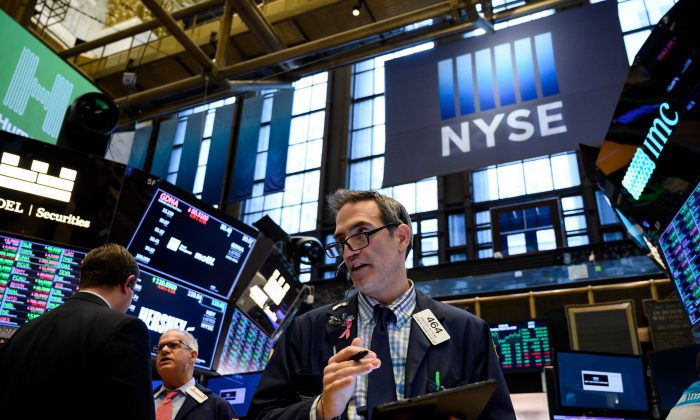 A trader works ahead of the closing bell on the floor of the New York Stock Exchange (NYSE) in New York City on March 18, 2019. (Johannes Eisele/AFP/Getty Images)