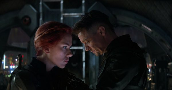 Scarlett Johansson, left, and Jeremy Renner in a scene