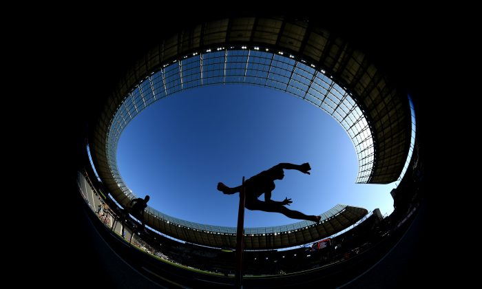 A hurdler competes at the Olympiastadion in Berlin on Aug. 6, 2018. (Matthias Hangst/Getty Images)