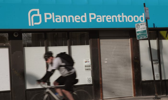 A cyclist rides past a Planned Parenthood clinic in Chicago, Illinois, on May 18, 2018.  Scott Olson/Getty Images