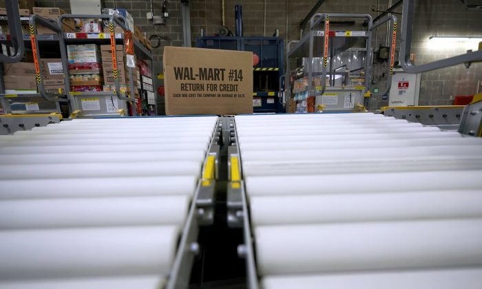 A box of merchandise is unloaded from a truck and sent along a conveyor belt at a Walmart Supercenter in Houston, on Nov. 9, 2018. (David J. Phillip/AP Photo)