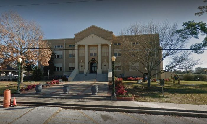 A small town near Houston, Texas, has decided to keep crosses on a county courthouse after a group demanded that they be taken down. (Google Street View)