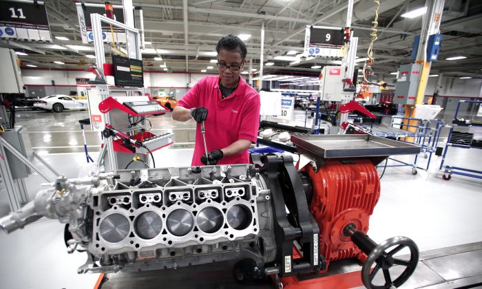 Angella Richberg works on an engine for a Dodge Viper at the Viper Assembly Plant in Detroit, Mich., on May 8, 2015.   (Bill Pugliano/Getty Images)