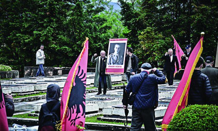 Communist supporters mark Martyrs' Day in Tirana, Albania with communist symbols and photos of communist dictator Enver Hoxha on May 5, 2019. (Antonio Çakshiri)