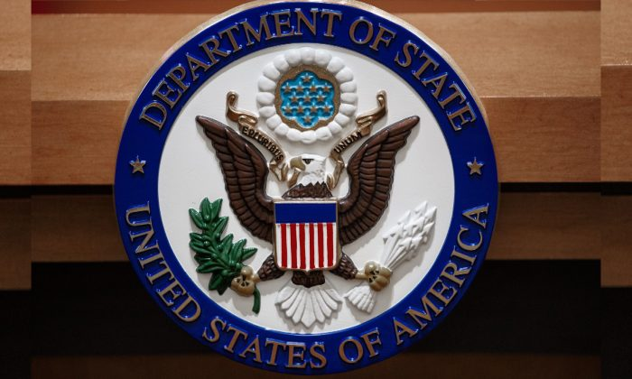 The U.S. Department of State seal as seen in the State Department briefing room in Washington in 2013. (Paul J. Richards/AFP/Getty Images)